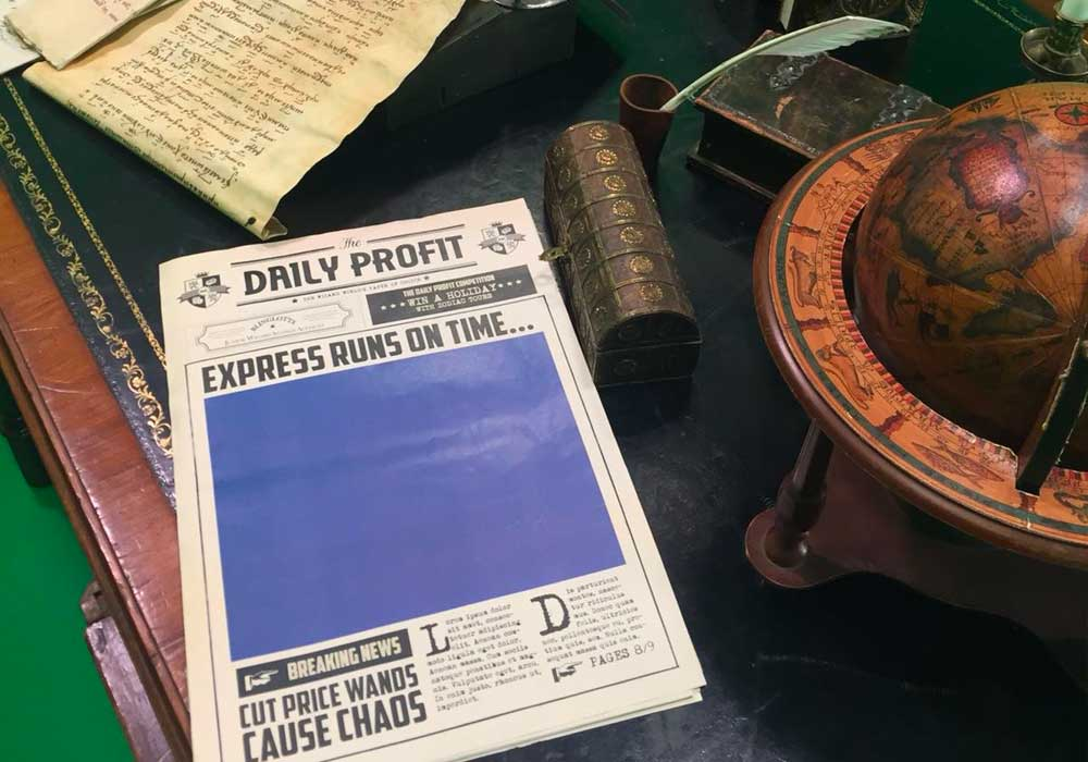 MLMS Show blue screen - Daily Profit newspaper with large blue square which was used to overlay moving imagery