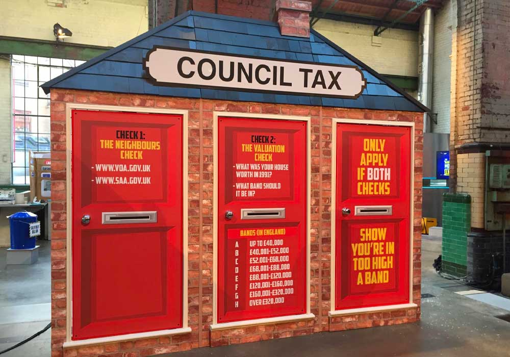 MLMS Council Tax Prop used on stage at a Live show - shows 3 doors within large building with Council Tax information onax facts